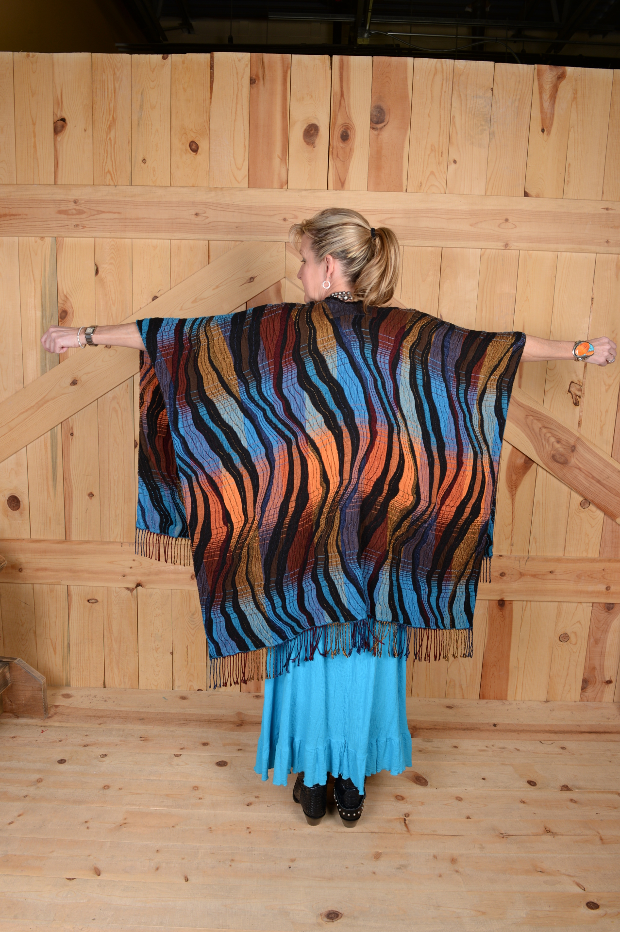 #100WTQ - TURQUOISE WAVE ITALIAN CAPE                      ONE SIZE - $169.95