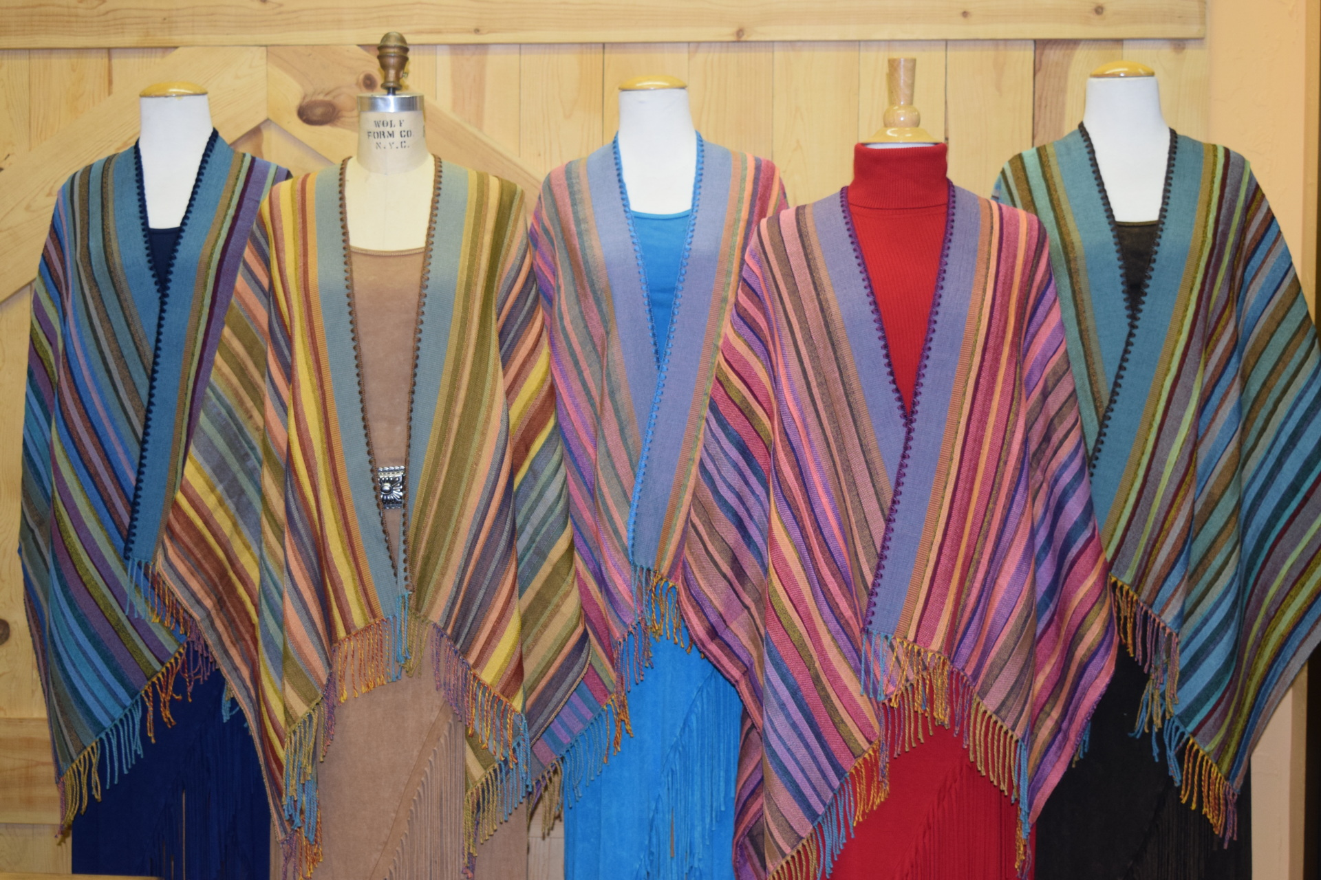 #100S - SERAPE STRIPE ITALIAN CAPES. Colors:  #02 Turq (navy stitch), Carnival, #03 Pink (turq. stitch), #04 Pink (Purple stitch) & #05 Jade (brown stitch).